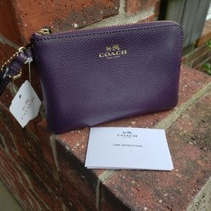 NWT coach purple wristlet f54626